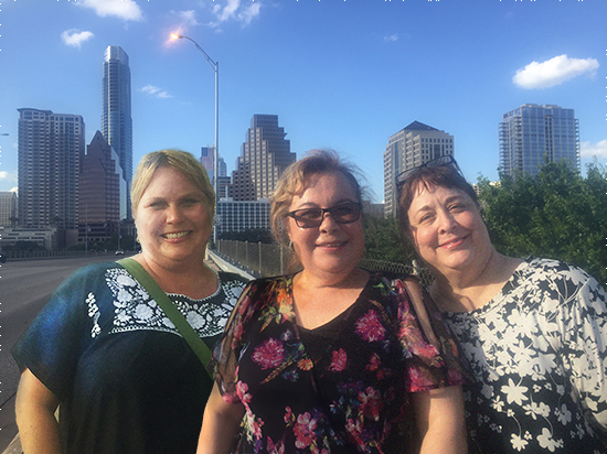 Three ladies standing on a bridge in Austin. TxEIS software.