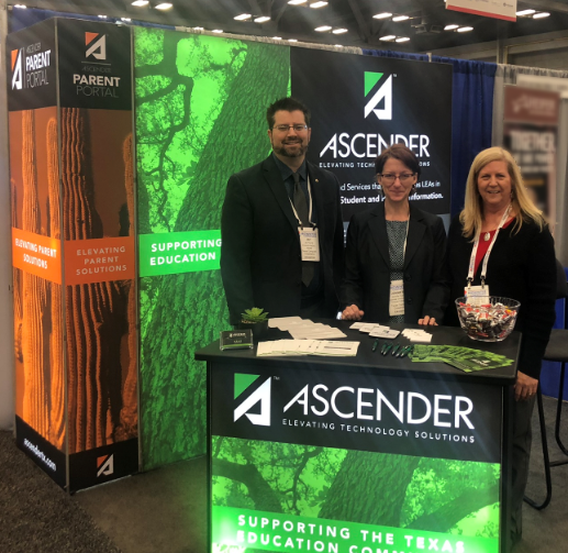 ASCENDER booth staffed by three TCC Employees